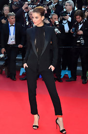 Barbara Palvin showed off her fierce side in a fitted black pantsuit at the Cannes premiere of 'Behind the Candelabra.'
