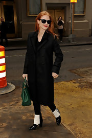 Jessica looked charming after her show in this velvet-trimmed black coat with clever pointed lapels.