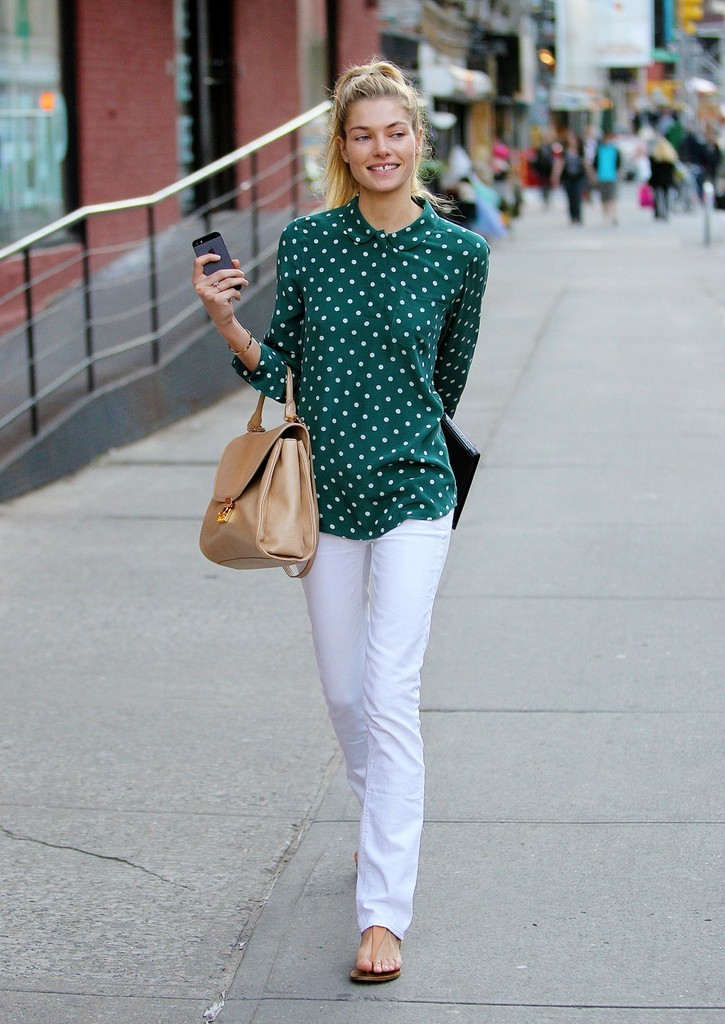 Model Jessica Hart carries her new iPhone 5 as she walks down the street in New York City.