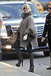 Jessica Simpson donned suede Fendi knee-high boots in NYC. She matched the taupe boots to her fur-trimmed coat.