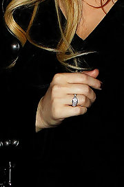 During a night out for dinner with her fiance, Jessica Simpson wore a large platinum and diamond ring on her right hand.