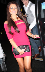 Jessica Wright toughened her sultry hot pink bandage dress with a skull-detailed clutch.