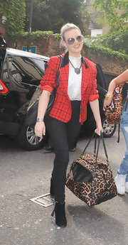Perrie carried this leopard-print duffle bag for her travel carryall.