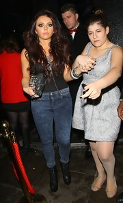 Jesy Nelson channeled an 80s vibe with a pair of skin-tight acid-wash jeans.