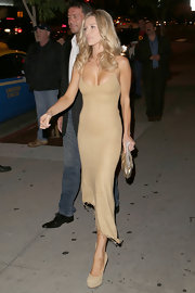Joanna Krupa opted for a golden asymmetrical-hemmed dress while out getting dinner.