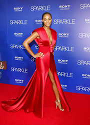 Tika Sumpter drew even more attention to her Angelina-esque slit with statement-making gold stilettos.