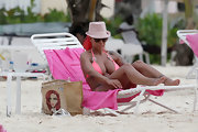 Jodie matched her bikini with this baby pink fedora whilst relaxing in Barbados.