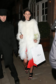 Liberty Ross covered up with this white furry coat while leaving the Dior party in London.