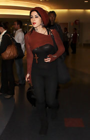 Kat Von D layered a cropped rust top over a sheer black tank for a sexy airport style.