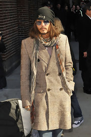 Johnny Depp showed his quirky style yet again with a retro-inspired tweed coat and long print scarf.