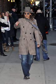 Leave it to Johnny Depp to combine a double breasted coat with distressed jeans and a wide brimmed hat... and still look cool.  Here's the fashionable leading man leaving the David Letterman show.