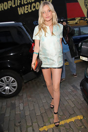 Laura Whitmore shined in a mint green brocade blouse and shorty shorts.
