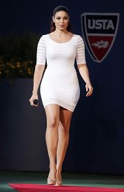 Jordin showed off her curves in this little white dress at the US Open.