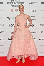 Elle Fanning was dressed like a princess in a petal pink organza gown with a swooping tea-length hem.