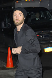 Jude Law wore a cable knit beanie with a pin-stripe suit for his appearance on 'Letterman.'