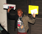 Oritse Williams looked oh-so-fun in his two-tone zip-up jacket and Mickey Mouse shirt.