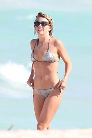 Pro-dancer and actress Julianne Hough hit the beach in a silver string bikini.