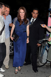 Julianne was spotted out on the town in a navy ensemble with delectable, reflective sandals.