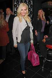 Jenny McCarthy layered her casual look with a light gray waterfall front blazer.