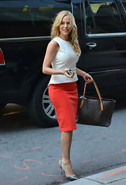 Julie Benz opted for a vibrant red pencil skirt to top off her chic daytime look.