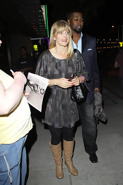 Natassja Kinski attended the Organic Liaison launch in flat tan slouchy boots.