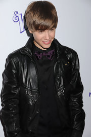 Justin wears a purple satin bowtie with his black button-up and leather jacket at the 'Never Say Never' premiere in New York.