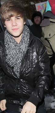 Justin dons a gray and black blended knit scarf, perfect for winter.