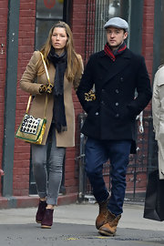 Jessica Biel's winter-wear popped against her printed shoulder bag with metallic gold trim.