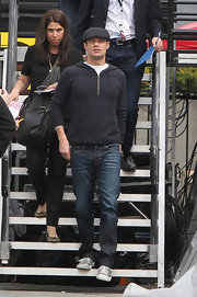 Ryan Seacrest sported a casual look with this gray hoodie and matching newsboy cap.