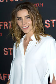 Clotilde Courau looked cool and casual with wavy locks while at the Studio Africa party in Paris.