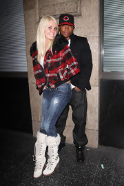 Karissa got cozy in a fur trimmed pair of white lace up boots with a wedge heel.