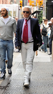 Karl walked the streets of Soho in a navy blazer and solid burgundy tie.