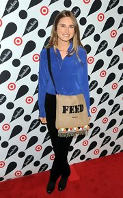 Lauren Bush carried her FEED USA bag at the Target + Neiman Marcus holiday collection launch in New York City.