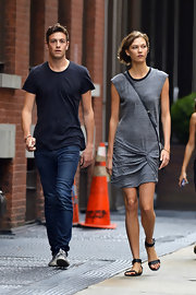 Karlie Kloss chose a laid-back gray knit dress for a stroll around New York City with her boyfriend.