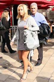 Kate Gosselin accessorized her striped mini dress with a blue buckled tote.