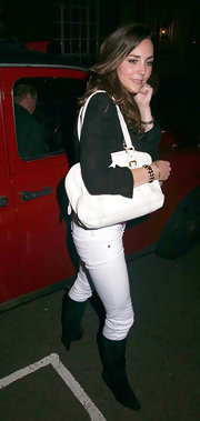 Kate Middleton carried a white leather shoulder bag with her casual clubbing attire.