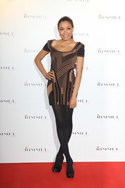Dionne Bromfield attended the Rimmel Party in London in a printed mini.
