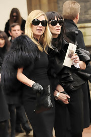 The stylish super model Kate moss was decked out in an all black ensemble for the funeral of designer Alexander McQueen. She topped her look off with a crocodile printed clutch.