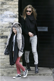 Kate Moss paired her animal-print skinny jeans with black leather ankle boots with buckled detailing.