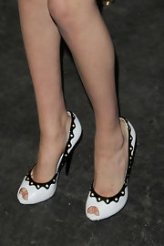 Kate wore darling white peep-toes with a black border.