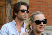Kate Winslet and her new boyfriend Louis Dowler hold hands as they stroll through the streets of Madrid.