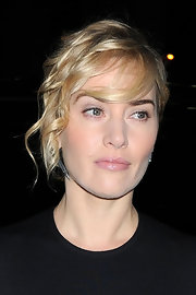 Kate Winslet wore her hair in a chic updo with softly side-swept bangs and face-framing curls at the CFDA Gala.