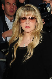 Aviator sunglasses and an all-black outfit gave Stevie Nicks a mysterious vibe.