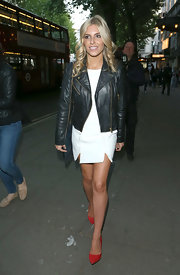 Red Kurt Geiger pumps added a punch of color to Mollie King's monochrome attire.