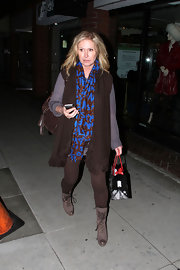 Kathy Hilton brightened up her monochromatic ensemble with a patterned Louis Vuitton scarf.