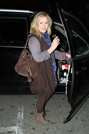 Kathy Hilton completed her boho shopping outfit with a tasseled brown hobo bag.