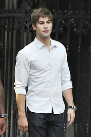 Chace Crawford paired his classic jeans with a white button down shirt.
