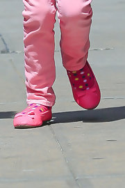 Ballet flats can be a practical option for little ones.  Suri's are bright pink with a bow.