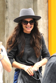 Katie Holmes tried to keep a low profile with a gray fedora and a pair of shades while strolling in New York City.