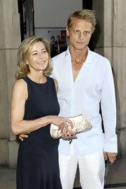 Claire Chazal carried herself stylishly—especially with a vintage-inspired gold satin clutch at her side.